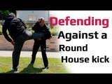 Defending against a roundhouse kick