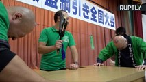 Japanese Men Go 'Head to Head' at Japanese Bald Championships