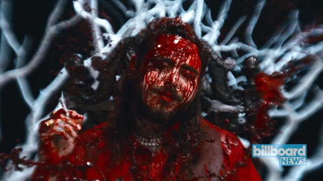 Post Malone & 21 Savage Unveil Bloody 'Rockstar' Music Video | Billboard News