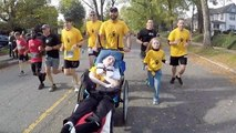 Best Friend Helps Paralyzed Buddy Compete In 5K