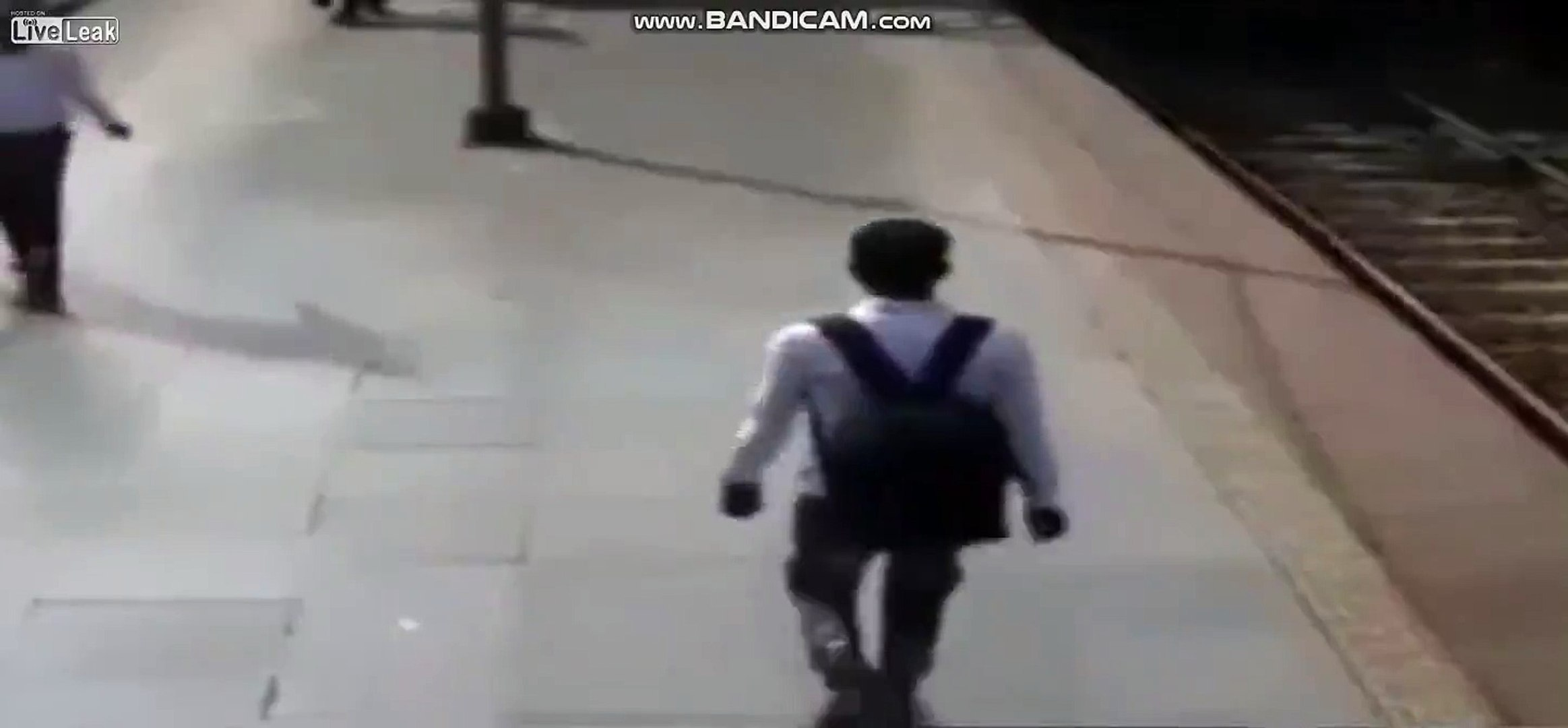 Man tries to catch a train, but train catches him