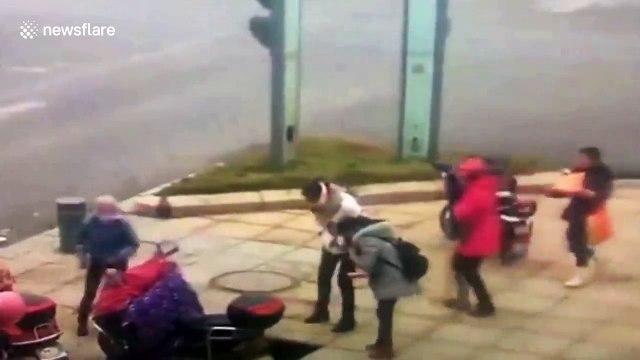 Pedestrian swallowed by sink hole when it opens on city street