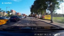 Cyclist sent spinning over car after running red light