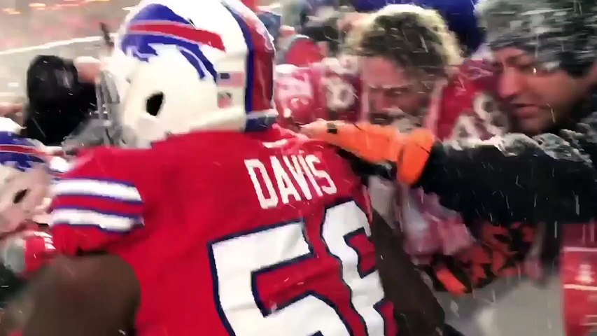 Buffalo Bills players celebrate the win in the snow with their fans