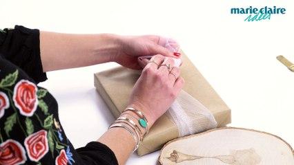 DIY paquet cadeau : utiliser des pompons et du tulle