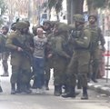 Blindfolded Boy Arrested by More than a Dozen Soldiers During Hebron During Protests