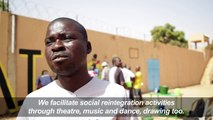 Cartoonists paint mural with inmates in Burkina jail