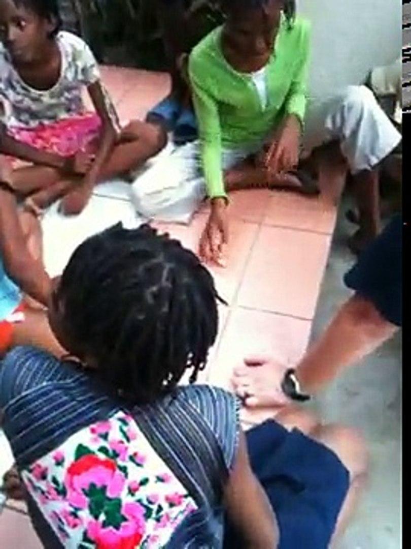 Kids playing Oscelet Haitian game