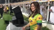 Shahid Afridi's Pakhtoons team shirt being distributed by Zareen Khan