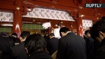 Japanese Businessmen Pray to Business Gods for Successful Year