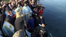 Orthodox Christians in swimming race for Epiphany