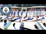 Incredible Human Mattress Dominoes in 4k - Guinness World Records