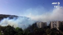 Hundreds evacuated as bushfires near Israel's Haifa-TOGXFggV020