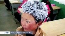 Un enfant chinois arrive avec les cheveux gelés en classe et déclenché un énorme élan de solidarité
