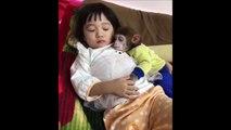 Little girl sleeping with her pet monkey