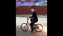 Hell Of A Ride: Guy rides bicycle with tires set on fire and fireworks attached to it