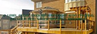 2 level cedar deck with wrought iron railings, pergola and stone walkout basemen