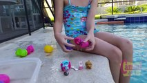 Diving for Surprise Eggs Girl Swimming Playing Underwater