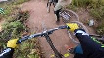 Guys Ride Mountain Bikes on Outdoor Track