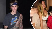 Love Yourself? Justin Bieber lifts shirt to show off tattooed torso while out alone on Valentine's Day... as Selena Gomez celebrates with friends.