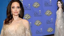 Angelina Jolie is honored at the ASC Awards... as it's claimed her ex Brad Pitt 'has kept in touch with newly-split Jennifer Aniston'.
