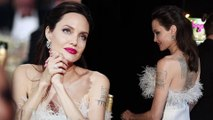 Angelina Jolie dazzles as she shows off tattoos at Critics' Choice Awards... after insider nixes romance rumors and says she won't date for a while.