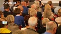 Merkel slams German auto execs during election rally