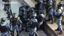 Police beat protester during Moscow anti-corruption protest