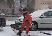 Slippery Santa Sleds Along Snowy French Street