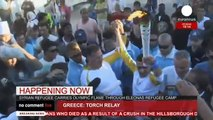 Athlete and war refugee Ibrahim Al-Hussein carries Olympic Torch