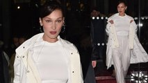 Bella Hadid flaunts her phenomenal figure in a tight white T-shirt and jogging bottoms as she enjoys a night out during Paris Fashion Week.