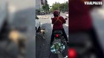 Dog Jumps Onto Motor bike