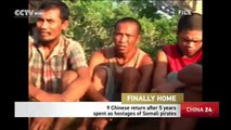 Nine Chinese return home after five years as hostages of Somali pirates