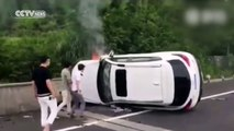 Passersby save couple trapped in overturned car on fire