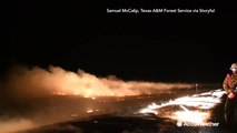 Night video shows Texas firefighters using 'burning out' technique to battle wildfire