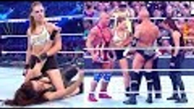 Ronda Rousey And Kurt Angle Destroy Stephanie And Triple H At WrestleMania 34 | Hollywood Buzz