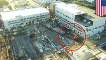 Giant crane collapses, nearly misses construction worker - TomoNews