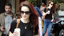 Michelle-Dockery-cuts-a-casual-figure-in-a-black -shirtand -jeans asshe-leaves-Cannes -afterwinning-festival-award