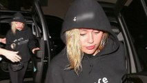 Miley Cyrus shows support for Noah in eyebrow raising top as she attends show with Liam Hemsworth.