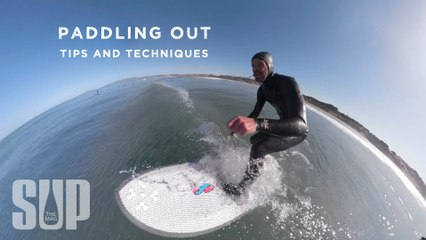 Paddling out through surf