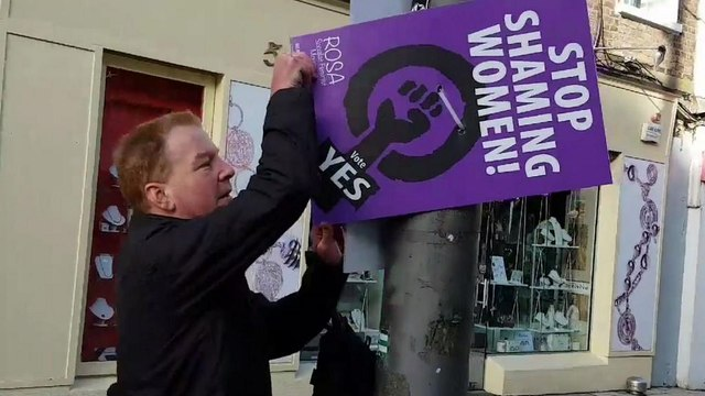 Watch: men caught tearing down pro-abortion posters in Ireland