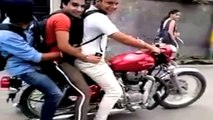 Three Indians on a Royal Enfield take a royal tumble!