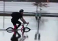 Bicyclist Navigates Floodwater Along St John River