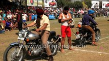 Indian holds on to two Royal Enfield bikes driving in opposing directions