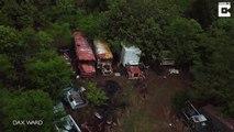Une foret couverte de centaines de voitures abandonnées