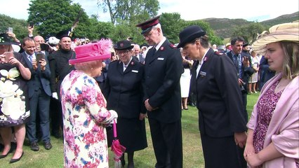 The Queen laughs with guests at Holyrood garden party