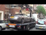 Aston Martin DB9 Volante being lifted and towed away in Knightsbridge, London