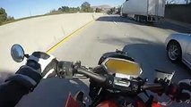 Dude is lucky to be alive! Motorcyclist Crashes And Slides Underneath Semi