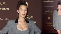 Bella Hadid looks busty in fitted mini dress and matching blazer at Cannes Film Festival.