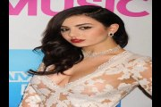Charli XCX in sheer white lace gown at Billboard Women in Music lunch